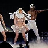 Gaga dances in a revealing nun costume.