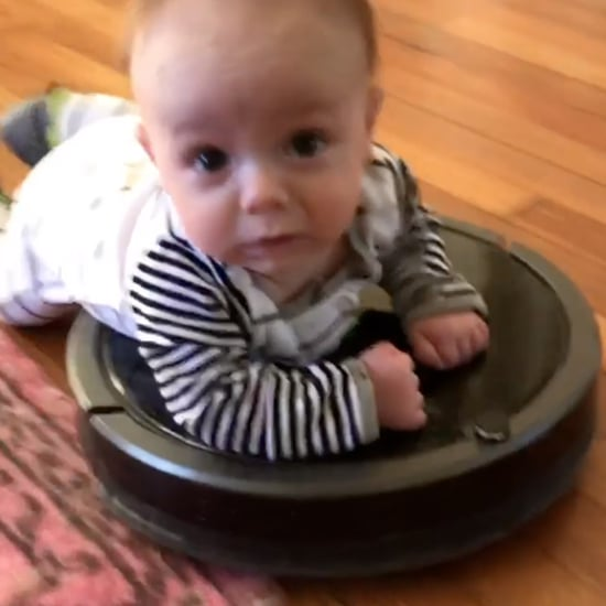Video of a Baby Riding a Roomba Vacuum Around the House