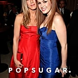 Jennifer Aniston posed with Isla Fisher at the Vanity Fair Oscars after party in Hollywood.