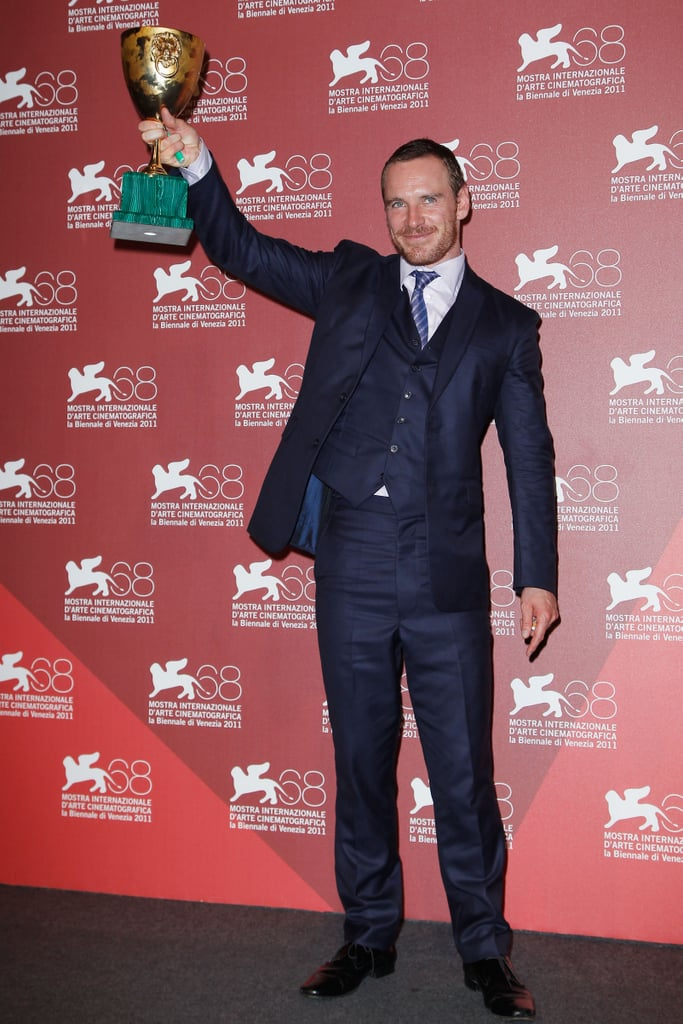 Michael Fassbender did a victory pump with his new Coppa Volpi prize during the Venice Film Festival on Saturday. Michael won the best actor honor from jury president Darren Aronofsky for his work in the Steve McQueen-directed Shame. Michael also had David Cronenberg's A Dangerous Method debuting at the Italian celebration of cinema, and both movies went on to be screened during the Toronto Film Festival over the weekend. Keira Knightley and Viggo Mortensen handled press for the Cronenberg picture Saturday, as Michael hopped on a plane and landed in Canada yesterday for a photo call with Steve.