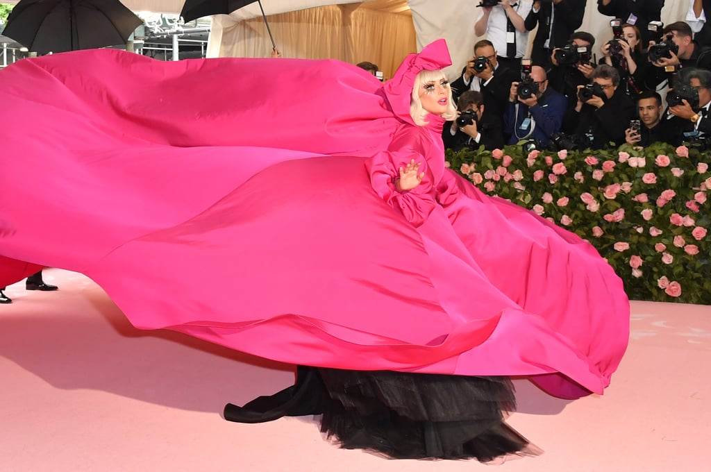 When we found out that Lady Gaga would be hosting this year's Met Gala alongside Harry Styles, Serena Williams, and Gucci's Creative Director Alessandro Michele, we knew it would be epic — and we were right! On Monday, Mother Monster kicked off fashion's biggest night by strutting down the famous stairs of NYC's Metropolitan Museum of Art not once, but four different times. The 33-year-old first showed up in a pink parachute Brandon Maxwell gown and then removed it to reveal a black dress underneath. But she wasn't done yet! From there, Gaga changed into a hot pink silk dress with a giant telephone in hand before ultimately stripping down to a black sequinned bra, underwear, and sheer tights. Given that Gaga has been hitting up the Met Gala since 2015, it's no surprise that she nailed the camp theme! Anyone else think we should rename the Met Gala to Met Gaga?      Related:                                                                                                           Look Back on Lady Gaga's Monstrous Rise to Fame