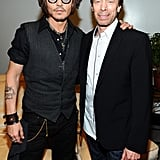 Johnny Depp had his arm around producer Jerry Bruckheimer at CinemaCon in Las Vegas.