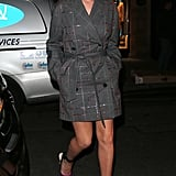 Rosie Huntington-Whiteley stayed warm in a belted trench and showed off her heels.