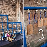 The escort cards lead to the 11 Who-themed tables and are arranged next to modern star props, a subtle nod to the show's sci-fi themes. Source: Green Wedding Shoes