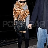 Nicole Richie paired a fur jacket with a ski hat.