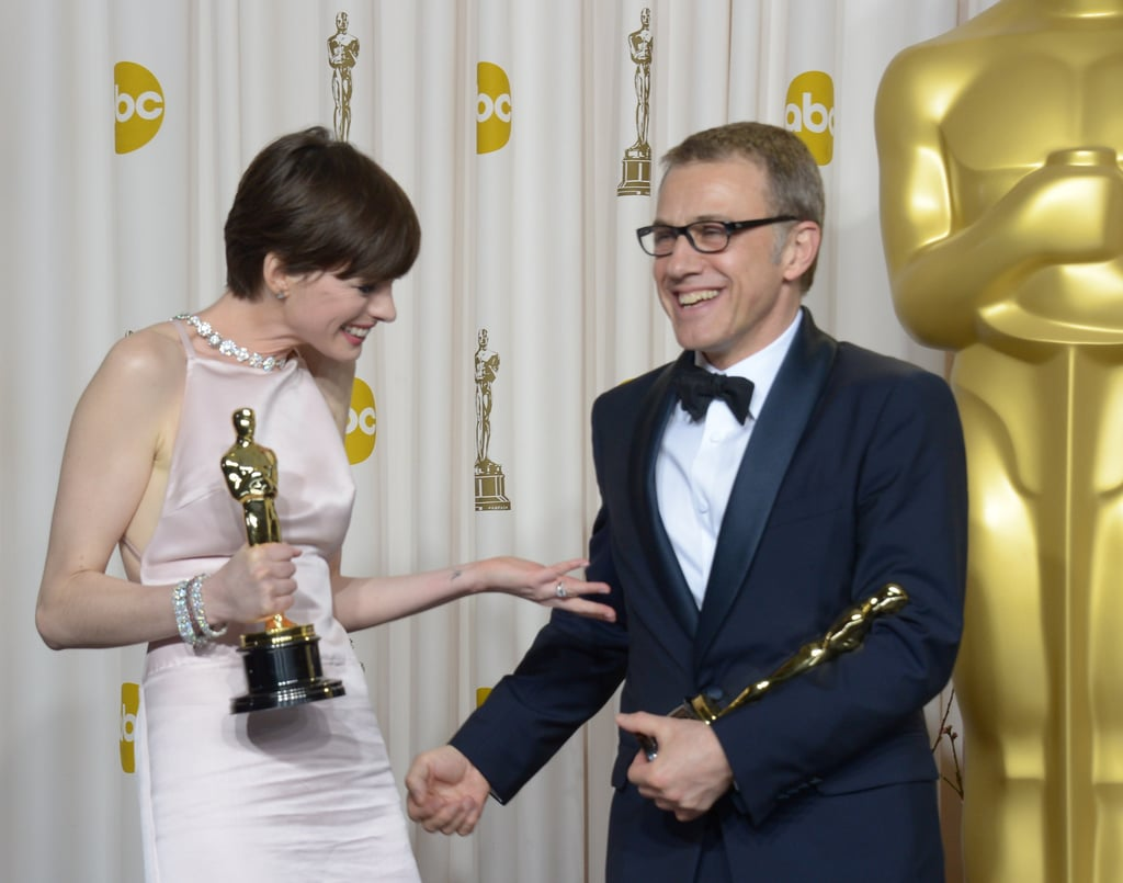 Anne Hathaway and Christoph Waltz celebrated their Oscar wins in the press room.