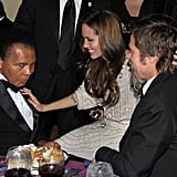 Angelina Jolie chatted with boxing legend Muhammad Ali and stroked Brad Pitt's hair at the December 2009 UNICEF Ball held in Beverly Hills.