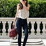 Miranda Kerr wore a tulip printed blouse from Equipment.