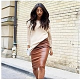 A Sweater and Leather Skirt
