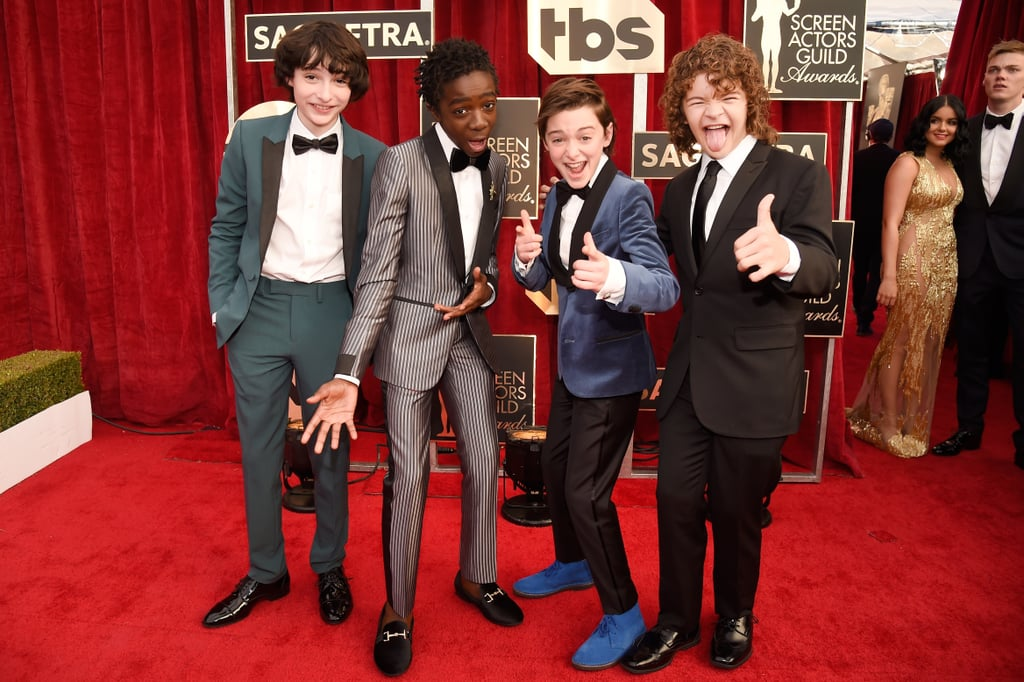 The cast of Stranger Things brought the fun to the Screen Actors Guild Awards on Sunday night. After partying together the night before, the hit show's younger cast — Millie Bobby Brown, Gaten Matarazzo, Noah Schnapp, Finn Wolfhard, and Caleb McLaughlin — all hit the red carpet in style. They were soon followed by older stars Natalia Dyer, Joe Keery, and Shannon Purser, who took some time for a few cute group photos. We have no doubt that they'll give their epic night at the Golden Globes a run for its money.      Related:                                                                                                           Someone Crown Sterling K. Brown and His Stunning Wife Award Season King and Queen