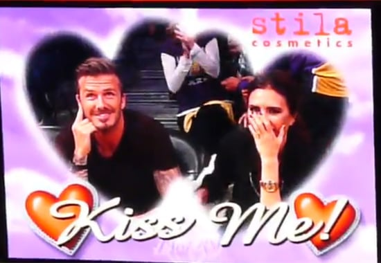 David Beckham and Victoria Beckham kissed on the Kiss Cam.