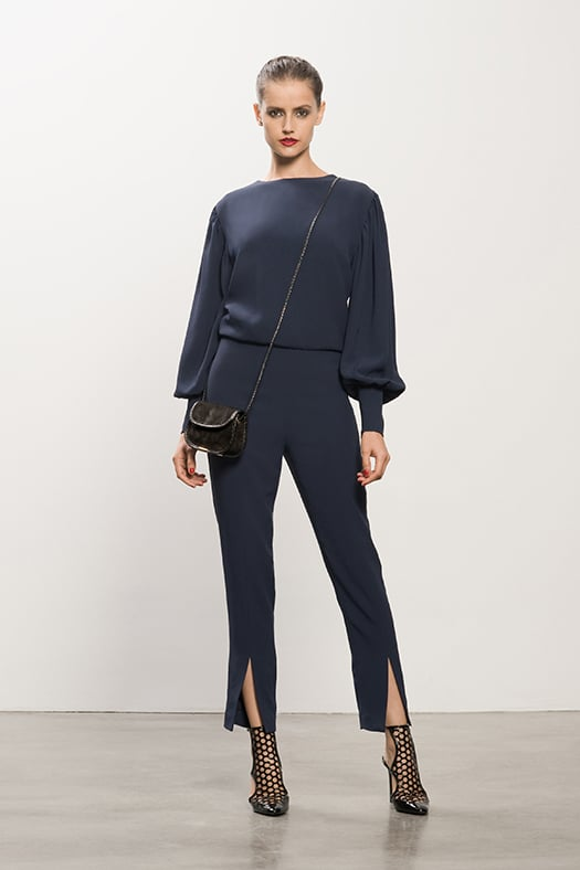 Crepe Navy Jumpsuit, Secret Place Black Open Back Bootie,Treasure Black Suede Cross Body Bag. Photo courtesy of Tamara Mellon