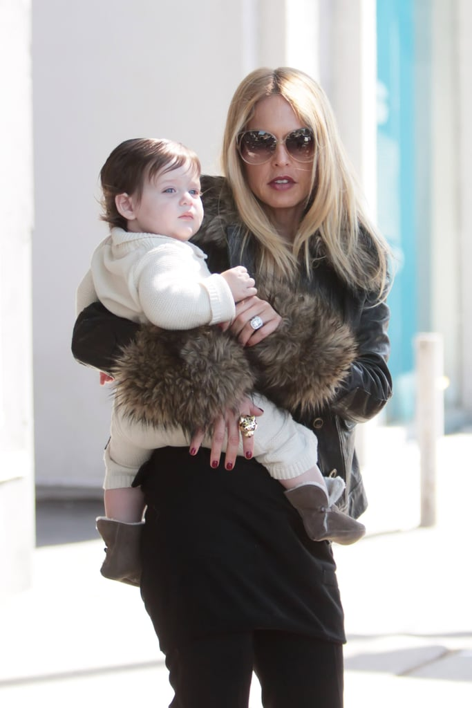 Rachel Zoe carried Skyler on her hip.