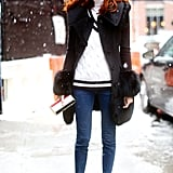 Taylor Tomasi Hill braved the snow in a pair of tasseled, heeled loafers and a fur-trimmed coat.