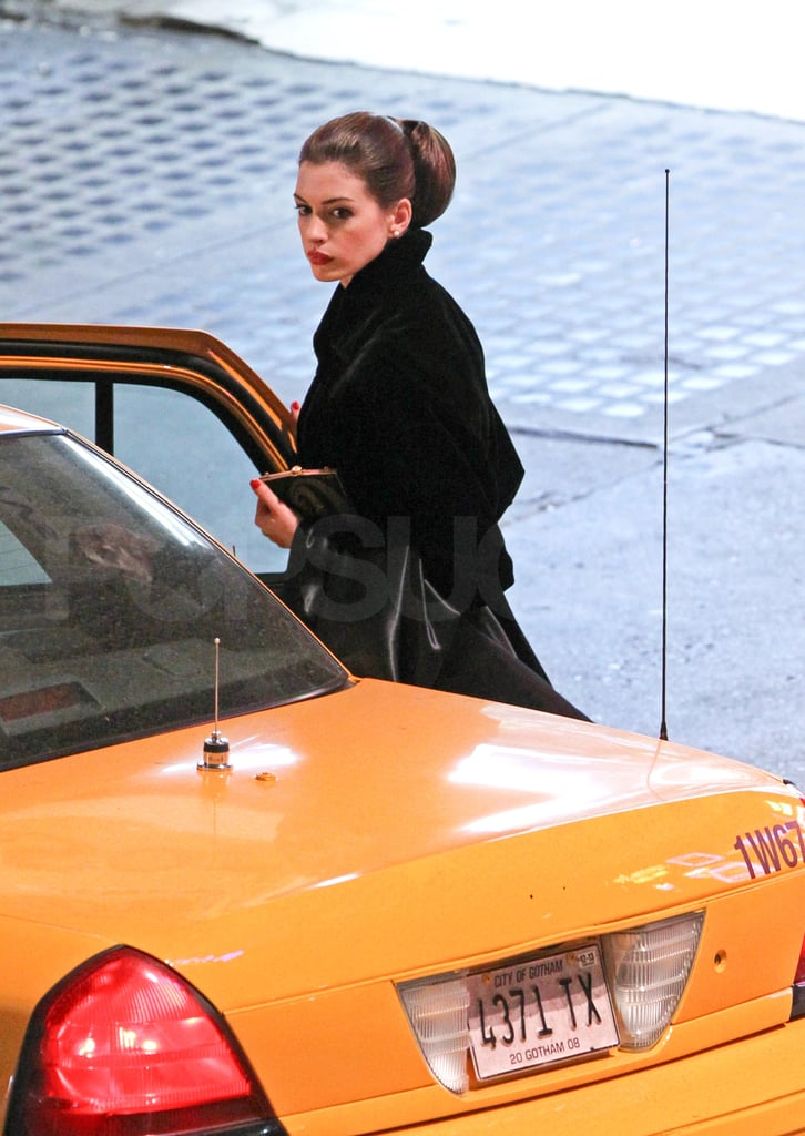 Anne Hathaway gets into a cab on set.