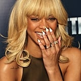 Rihanna couldn't contain her laughter at a photocall for Battleship in London.