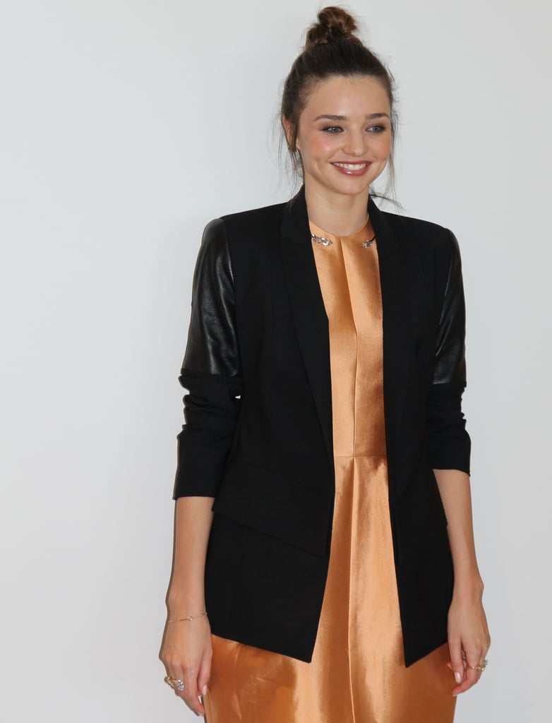 Miranda wore a leather-sleeved blazer and cocktail dress, both by Ellery.