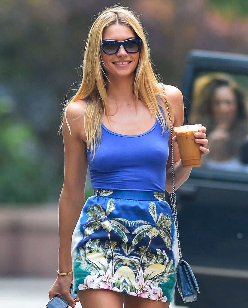 Jessica Hart's blue sunglasses coordinated with her Summer style in NYC. Get the look with these Ray-Ban classic Wayfarers in blue ($150).