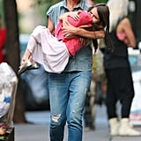 Katie Holmes Carries Suri Cruise Around the City
