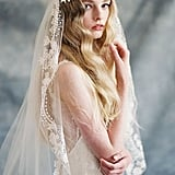 Cotton threadwork forms an organic motif of vines and leaves in this bohemian-style veil ($500).