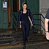 She was also spotted styling her leggings with a moto jacket and some booties.