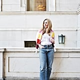For a dressed-down look, I teamed my puffy sleeve top with '90s-inspired jeans and block-heel sandals. Craving a transitional layer with a splash of color, I tossed a colorblock sweater over my shoulders for easy-chic.   On Laura: POPSUGAR at Kohl's puff-sleeve button-down top, Agolde jeans, PH5 sweater, Charles & Keith sandals.
