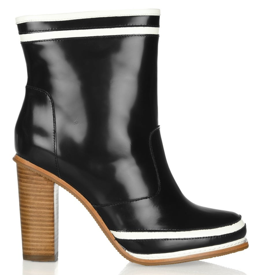 The finish reminds us of a traditional rain boot, but we love that Diane von Furstenberg added a stacked wooden heel for a more refined feel. Diane Von Furstenberg Rubber and Leather Ankle Boots ($350)