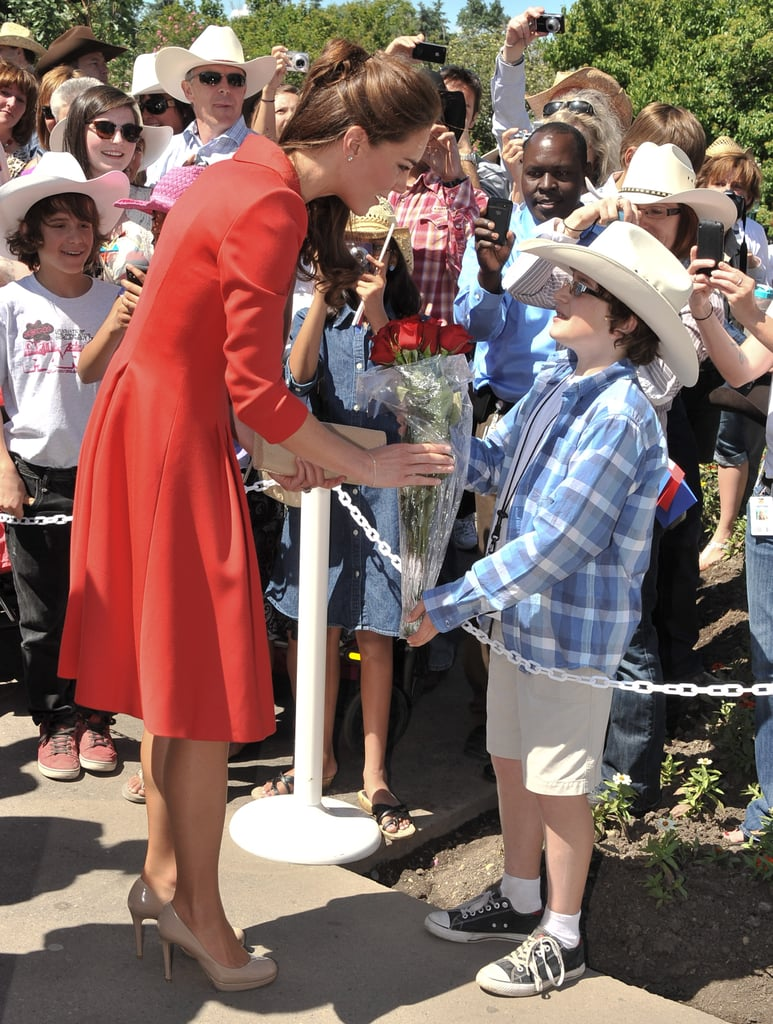 Kate Middleton was greeted by a cute little boy in a cowboy hat at the Calgary Zoo in July 2011.