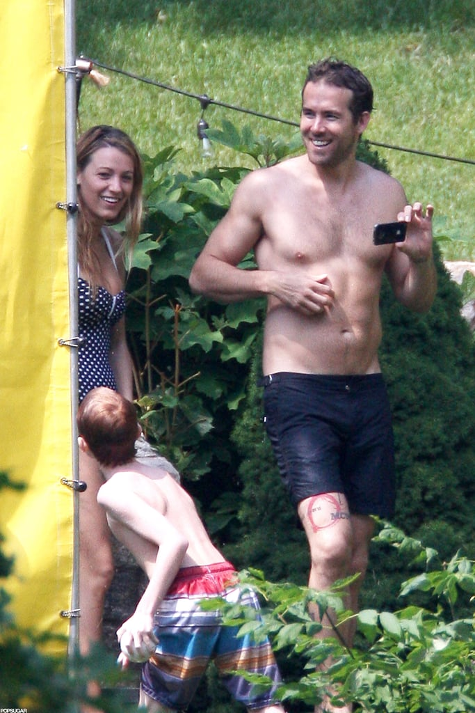 Ryan Reynolds showed off his toned abs while spending the Fourth of July with Blake Lively in New York.