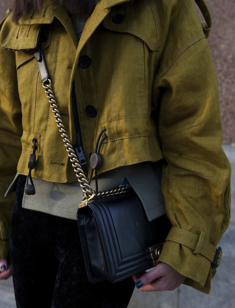 A black chain-link Chanel bag got paired up with a cropped anorak jacket.