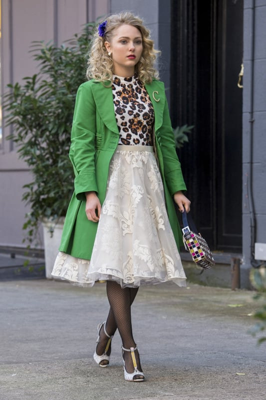 Carrie strutted the NYC streets in a leopard Topshop top, embroidered Tulle skirt, and metallic t-strap pumps, then finished with a kelly green coat. Don this Loft mini ($65, originally $80).
