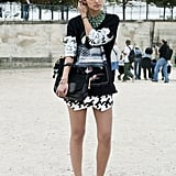 She worked a bold print mix and an even bolder necklace.