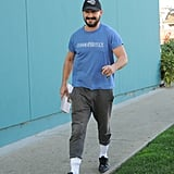 Shia makes tucking high socks over a pair of joggers look cool.