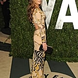 Kate Beckinsale usually sticks with solids, but last night, the actress opted for a printed body-con cutout gown by Roberto Cavalli.