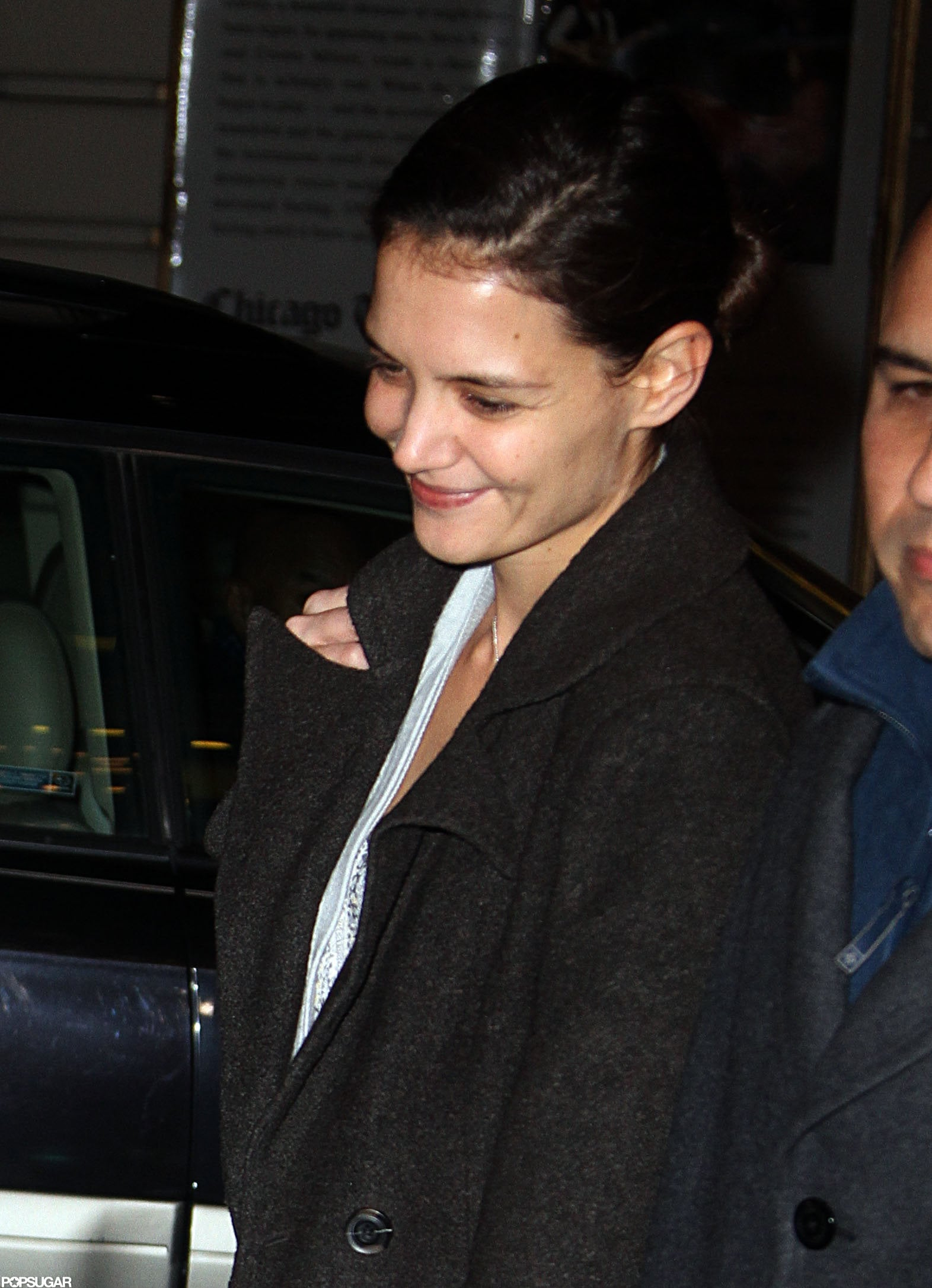 Katie Holmes left her Broadway show smiling.