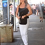 Jen traded her green slacks for white when she stepped out again in NYC in June 2016, wearing her bag from The Row.