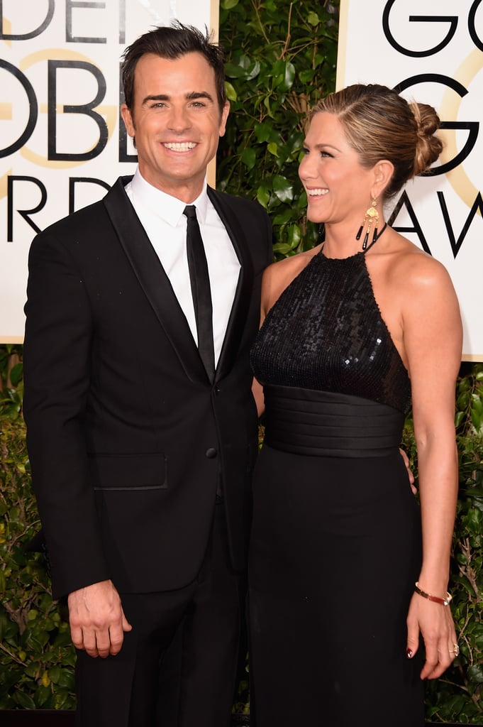 Jennifer Aniston flashed a big grin when she hit the red carpet with Justin Theroux at the Golden Globes on Sunday. It's an exciting night for Jennifer, who donned a long black Saint Laurent gown for the show. Not only is she among this year's Golden Globe nominees thanks to her leading role in Cake, but she was also the night's first presenter, alongside Benedict Cumberbatch. Take a look at the best pictures from Jennifer and Justin's night, and then check out all the celebrity couples at the Golden Globes!