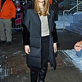 Jessica Biel kept warm outside in a black puffer coat, oatmeal sweater, and black skinnies.