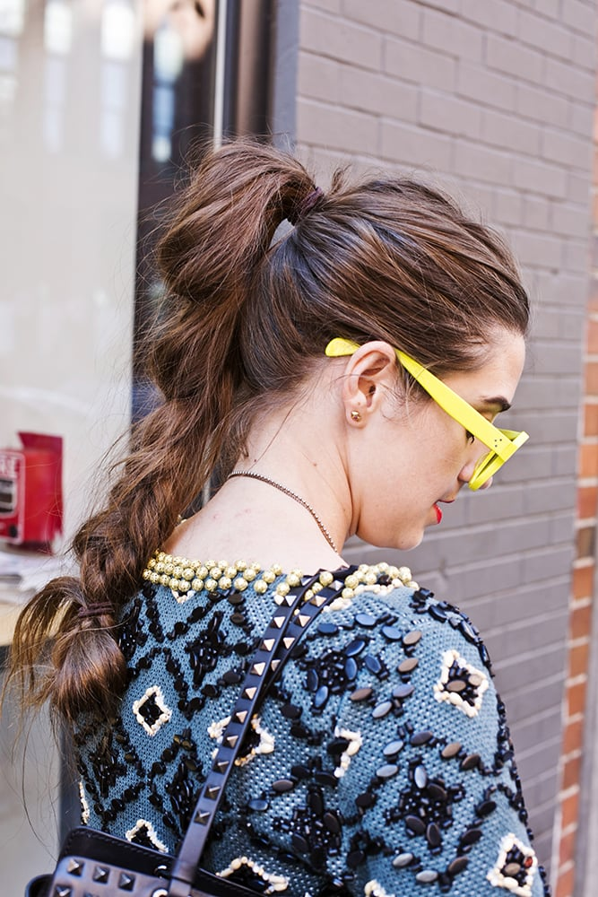 Bored with your regular ponytail-braid combination? Take a note from this girl, then, and pull the end halfway through the elastic. Photo by Caroline Voagen Nelson