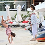Stephanie Seymour held onto a towel and Frisbee.