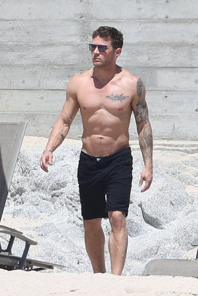 Ryan Phillippe made our hearts skip a beat when he was spotted soaking up the sun at the beach in Cabo, Mexico, recently. The 43-year-old actor flexed his chiseled physique while walking along the shore and also debuted a new winged-figure tattoo on his chest. If that weren't enough to make you dehydrated, Ryan splashed water on himself at one point, leaving his body glistening under the hot sun. Swoon. Keep reading to see more from his shirtless day at the beach, then go get a cup of water — or 50 — because you'll likely need it after seeing these photos.      Related:                                                                                                           The 32 Types of Swag Ryan Phillippe Has