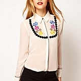 Punch up your white-blouse quotient with a necklace-embroidered iteration. It's fun, playful, and quite the statement piece. ASOS Shirt With Embroidered Necklace ($69)