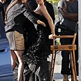 Kim Kardashian was adjusted while wearing a stunning black gown for Vogue Italia.