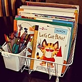 Organize stickers and coloring books in a dish rack.