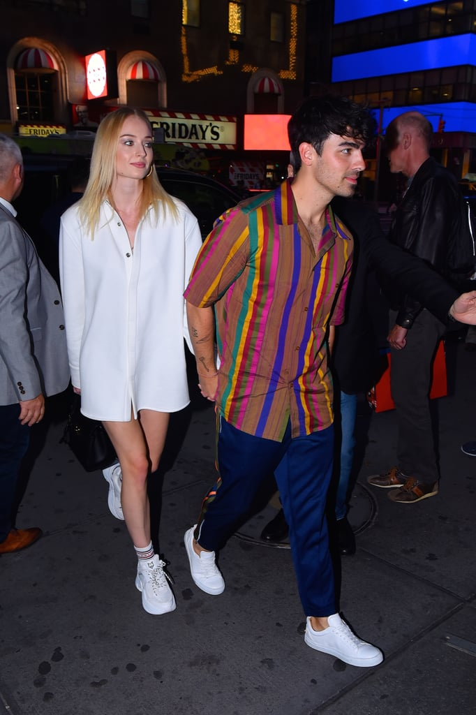 Sophie Turner in an Oversize White Button-Down and Sneakers in 2019