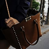 Studs took this brown leather tote to an edgier place.