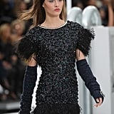 Black Fingerless Gloves Completed a Feathered Dress