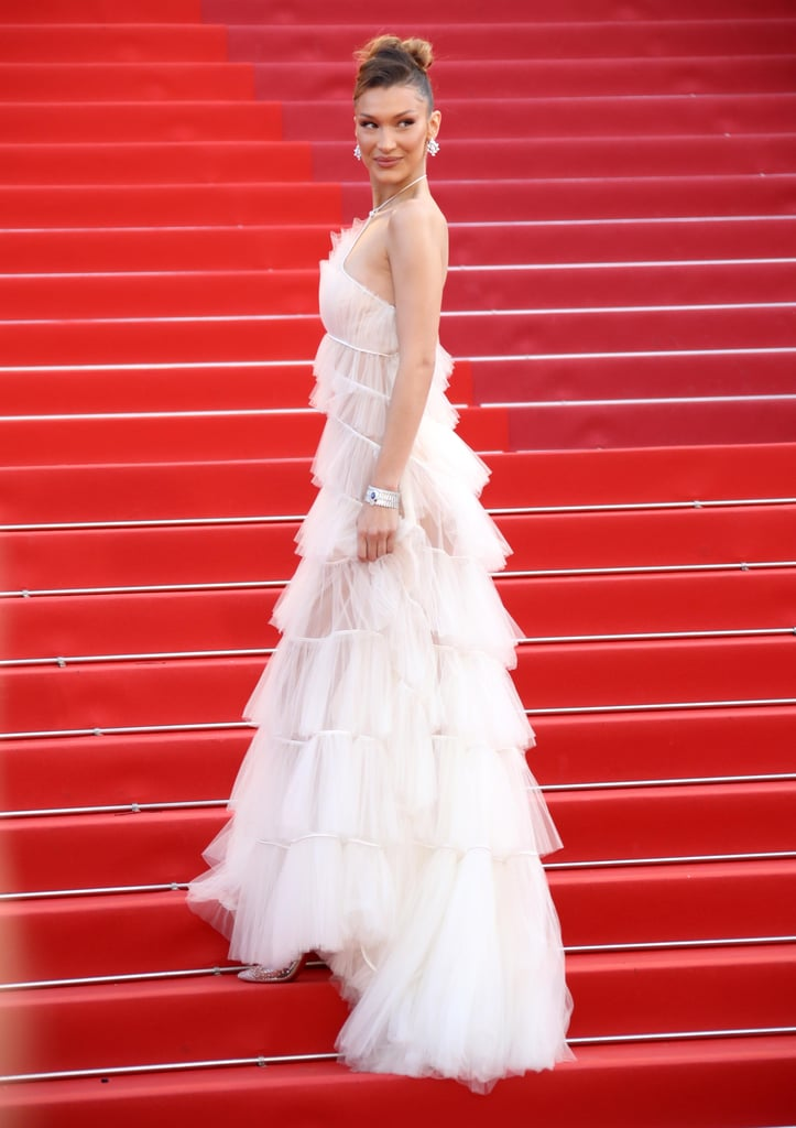 After seeing Bella Hadid's latest look at the Cannes Film Festival, we're ready to get down on one knee. At the Rocketman premiere on May 16, the model wore an ethereal Dior Haute Couture gown that looked not unlike a wedding dress — a very, very sexy wedding dress. She complemented the pleated tulle design with embellished Christian Louboutin heels and a lot of diamonds by Bulgari.  The stunning appearance comes a day after Bella wore a nude ballerina-like Dior outfit to a dinner hosted by the brand in conjunction with Vogue Paris. Bella also has a history of really bringing it for the film festival, her leg-baring Alexandre Vauthier number from 2016 being particularly memorable. See photos of her red-carpet-meets-bridal moment ahead, and then catch up on other major Cannes fashion moments so far.      Related:                                                                                                           Whoa! Deepika Padukone Served Up a Major Fashion Moment at Cannes, and the World Was Not Ready For This