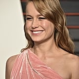 Brie Larson Accessorizes Her Oscars Afterparty Look With Major, Major Gold