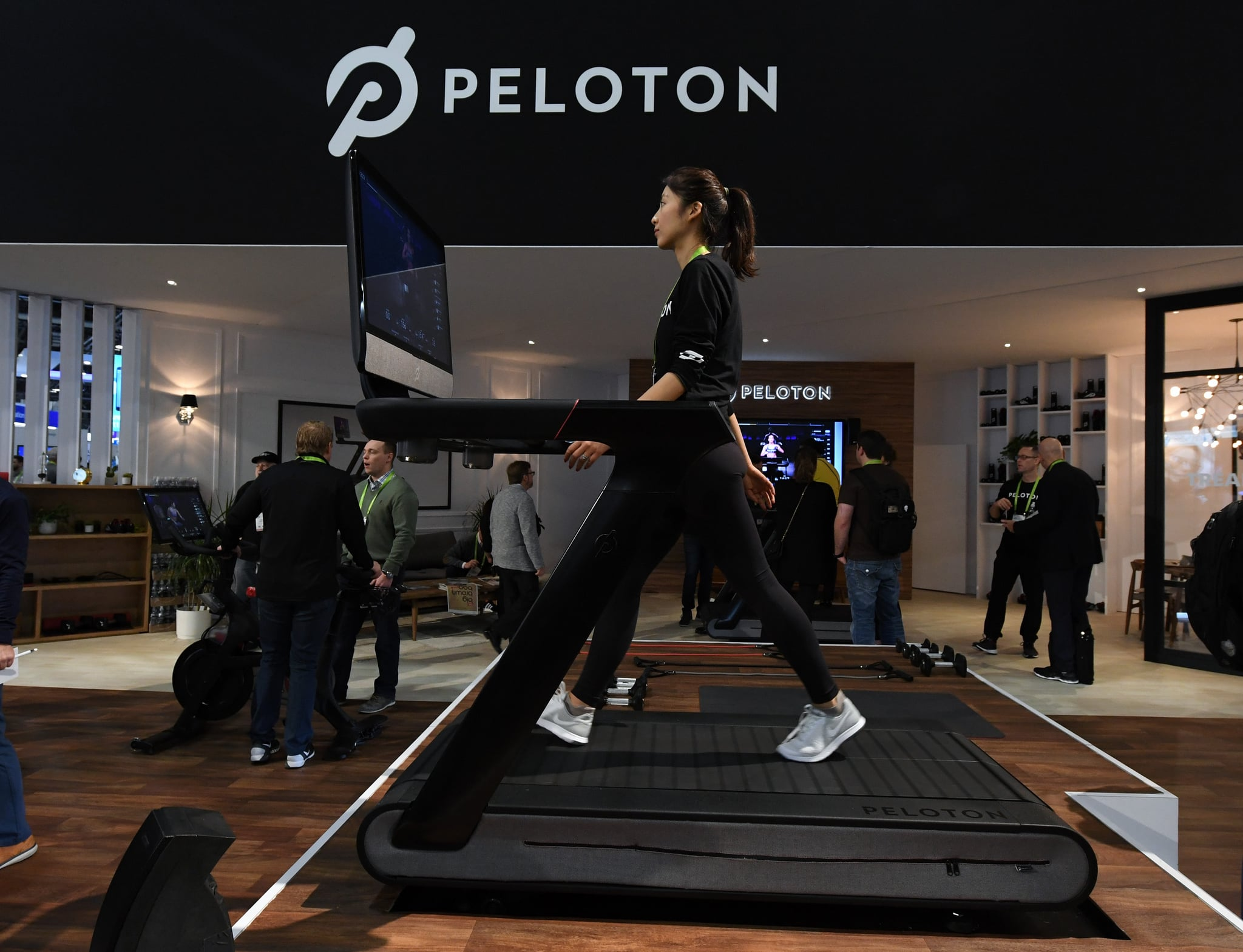 LAS VEGAS, NV - JANUARY 11:  Maggie Lu uses a Peloton Tread treadmill during CES 2018 at the Las Vegas Convention Center on January 11, 2018 in Las Vegas, Nevada. The USD 3,995 workout machine is expected to be available later this year and features a 32-inch touch screen that connects users to instructors giving live or on-demand fitness classes. CES, the world's largest annual consumer technology trade show, runs through January 12 and features about 3,900 exhibitors showing off their latest products and services to more than 170,000 attendees.  (Photo by Ethan Miller/Getty Images)